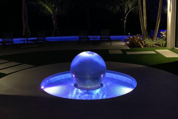lighted-garden-fountain-at-night