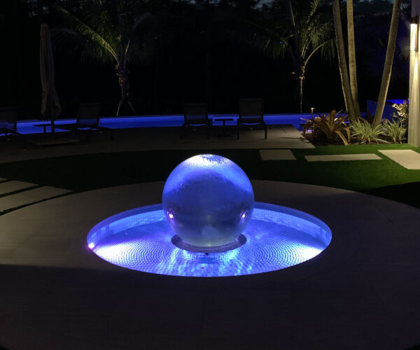 lighted-garden-fountain-at-night