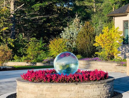 sphere-fountain-in-center-driveway-garden